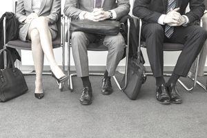 Business people waiting for a media job interview