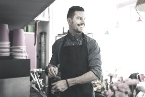 male barista working in coffee shop