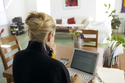 Woman writing email on computer