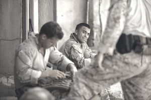 United States Marines relax in combat.