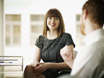 Woman and man in an interview