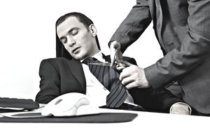 Partially visible man cutting off the tie of sleeping businessman