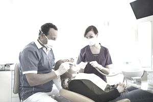 Dentist operating on patient