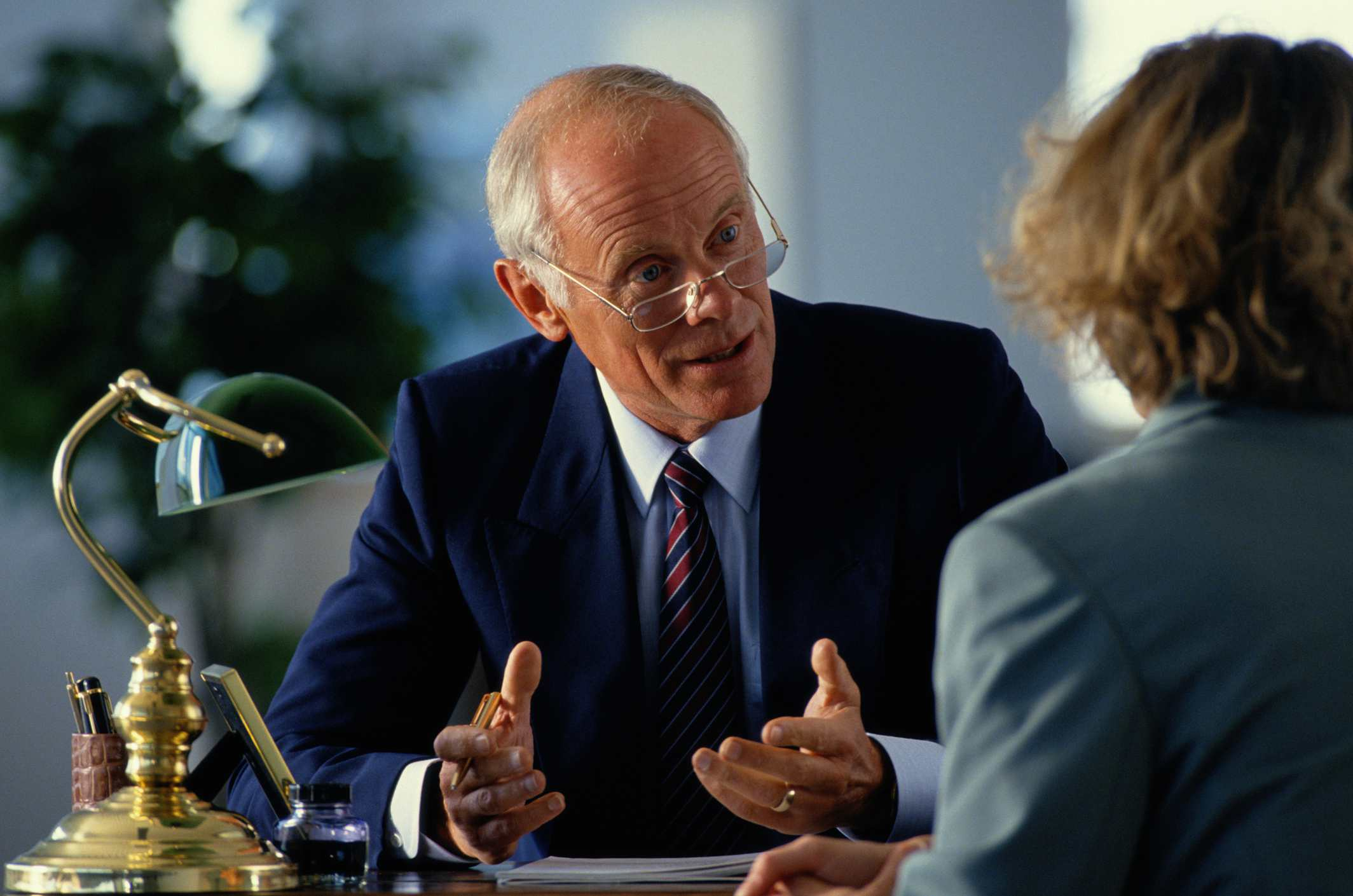 WOMAN MEETING WITH LAWYER OR LEGAL ADVISOR