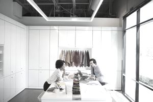 Designers discussing fabric swatches in conference room meeting