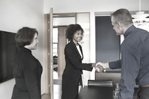 Businesspeople making handshake at job interview