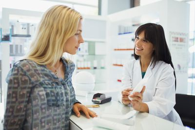A pharmacist talks with a patient.