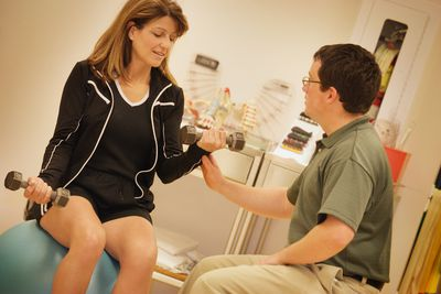 Occupational therapist with a patient