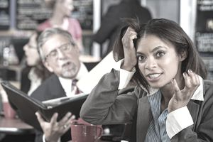 Annoyed female pulling her hair as she listens to the resident negative employee. Is it you?