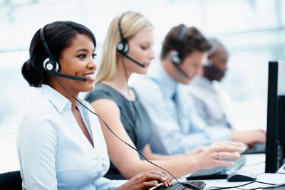 Employees with headsets on working in a call center