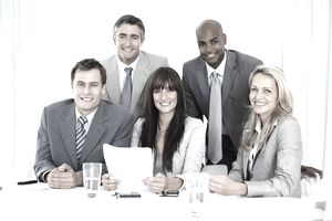 Business team with paperwork is able to practice adaptive leadership in the changing workplace.