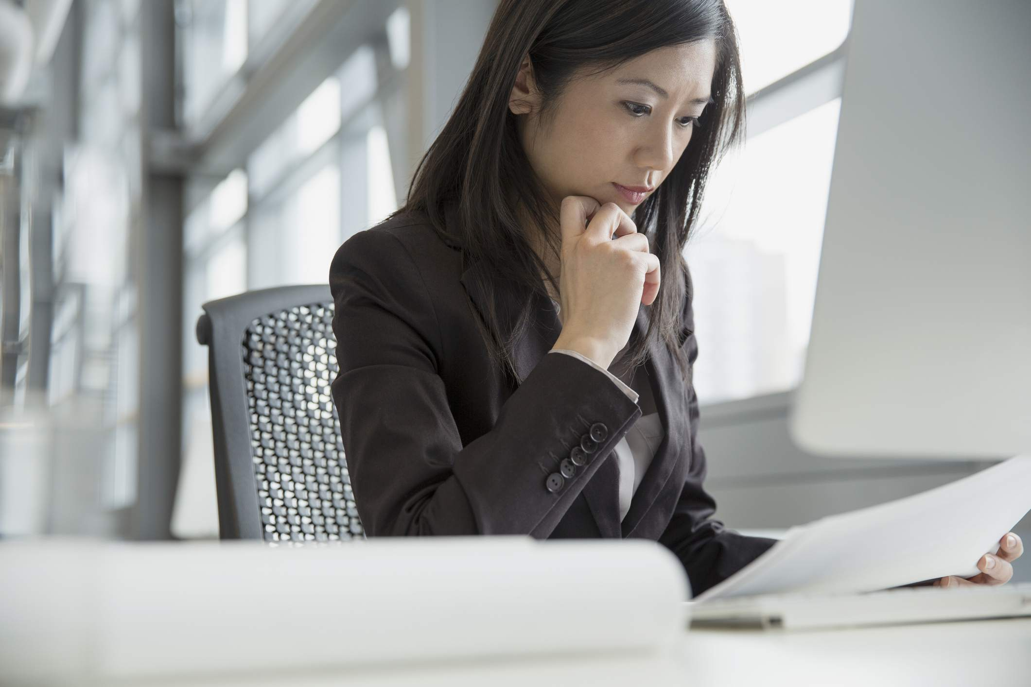 document reviewer looking at legal documents