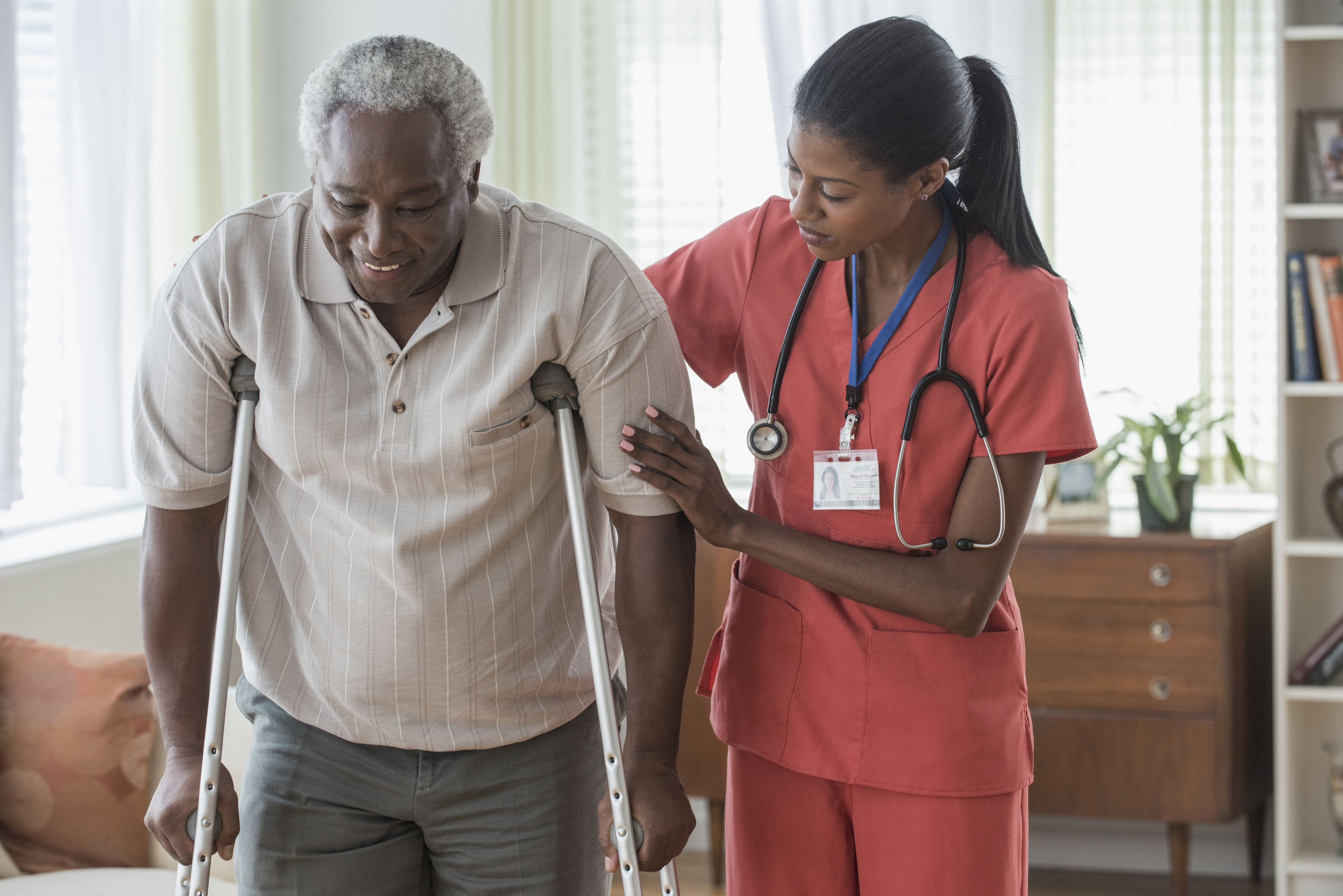 Home health aide or home care aide with a patient in his home