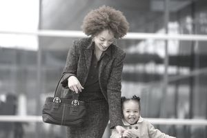 Working Mom Holding Daughter's Hand