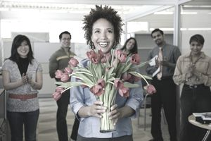 Businesswoman holding bouquet of flowers