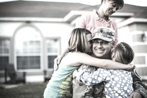 Family welcoming army father