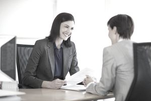 Woman interviewing job candidate
