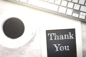 Thank you with coffee and keyboard
