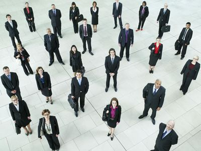 Group of Business Professionals Looking Up at Camera
