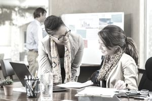 Diverse businesswomen work together on project
