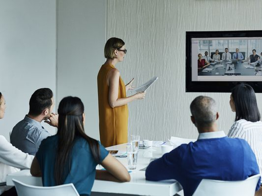 Businesswoman giving presentation to colleagues