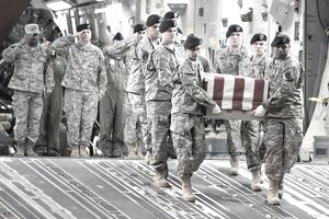 soldiers carrying a flag-draped casket