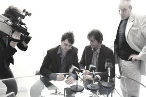 Pop Musicians Signing a Contract in a Conference Room Attended by Their Manager and a TV crew