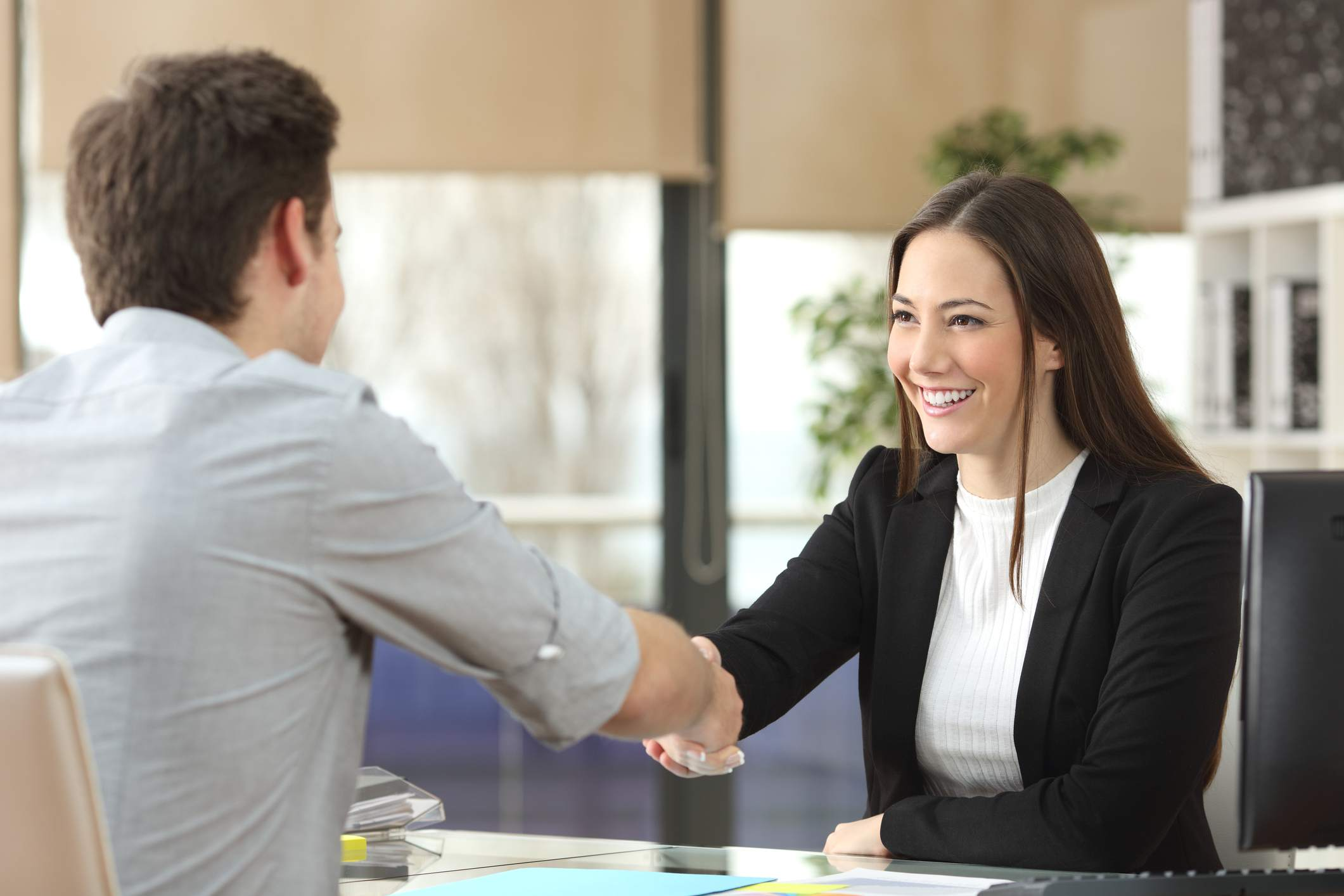 Student handshaking with client closing deal