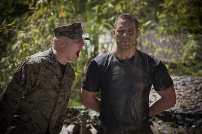 A drill instructor with recruit.