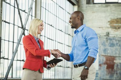 Salesperson shaking hands with potential customer
