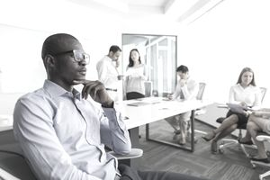 Businessman thinking during meeting in office