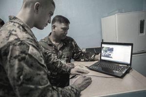 Philippine Air Force Staff Sgt. Brian V. Vinuya, back, and U.S. Marine Sgt. Erick Lallemand Jr., both meteorology and oceanography analyst forecasters, observe weather conditions Oct. 9 at Clark Air Field, Pampanga, Republic of the Philippines during Amphibious Landing Exercise 2014. U.S. Marine forecasters with 3d Marine Expeditionary Brigade work seven days a week with their Philippine Air Force counterparts to ensure the safety of service members and the success of Amphibious Landing Exercise 2014. PHIBLEX 14 is a bilateral training exercise designed to demonstrate the commitment of the United States and Republic of the Philippines to mutual security, and ensures the readiness of a bilateral force to rapidly respond to regional humanitarian crises. Vinuya is with 900th Air Force Weather Group and Lallemand is with 3d Marine Expeditionary Brigade, III Marine Expeditionary Force.