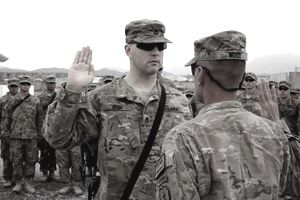 Col. Todd R. Wood, commander of the 1st Stryker Brigade Combat Team, 25th Infantry Division, administers the oath of re-enlistment to Staff Sgt. Brian Beem, a cavalry scout assigned to the 5th Squadron, 1st Cavalry Regiment during a special ceremony at Forward Operating Base Frontenac, Nov. 9.