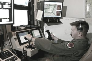 CREECH AIR FORCE BASE, NV - AUGUST 08: United States Air Force Senior Airman William Swain operates a sensor control station for an MQ-9 Reaper during a training mission August 8, 2007 at Creech Air Force Base in Indian Springs, Nevada.