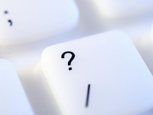 Close-up of a question mark key on a keyboard