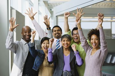 Group of business people celebrating the fruits of their commitment in office