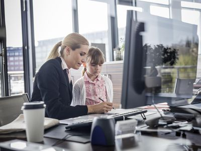 Mom and young daughter in office