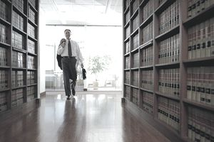 Lawyer Entering a Law Library