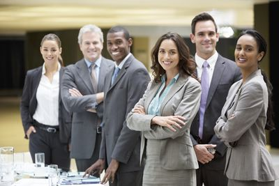 a627453d4f5 Business team wearing business formal work attire and smiling.