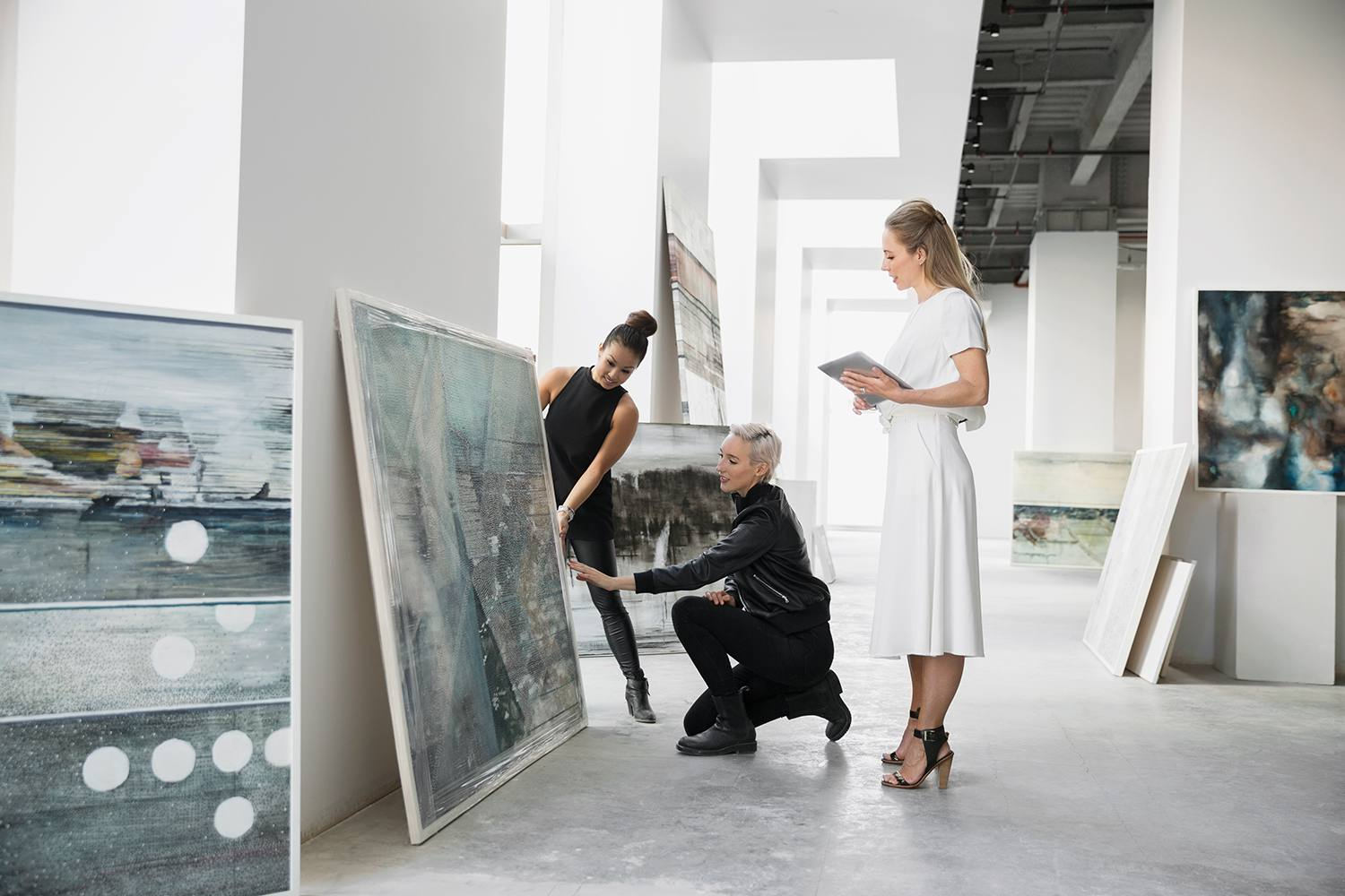 Curator and art dealers discussing paintings