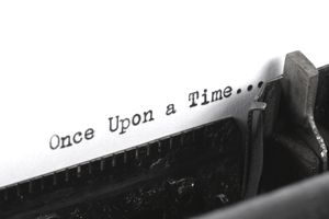"the words ""once upon a time..."" typed on paper"