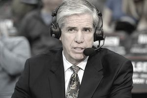 Basketball announcer Jim Spanarkel wearing a headset and commenting on a game.