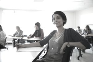Woman attending a class paid for with employer tuition assistance.