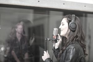 Woman recording music at studio