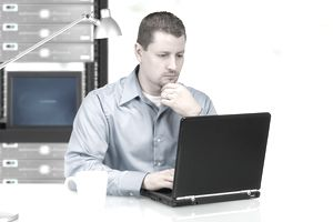 a young man working on a laptop