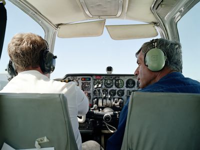 Pilots in cockpit of small airplane