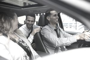 Business people carpooling in car