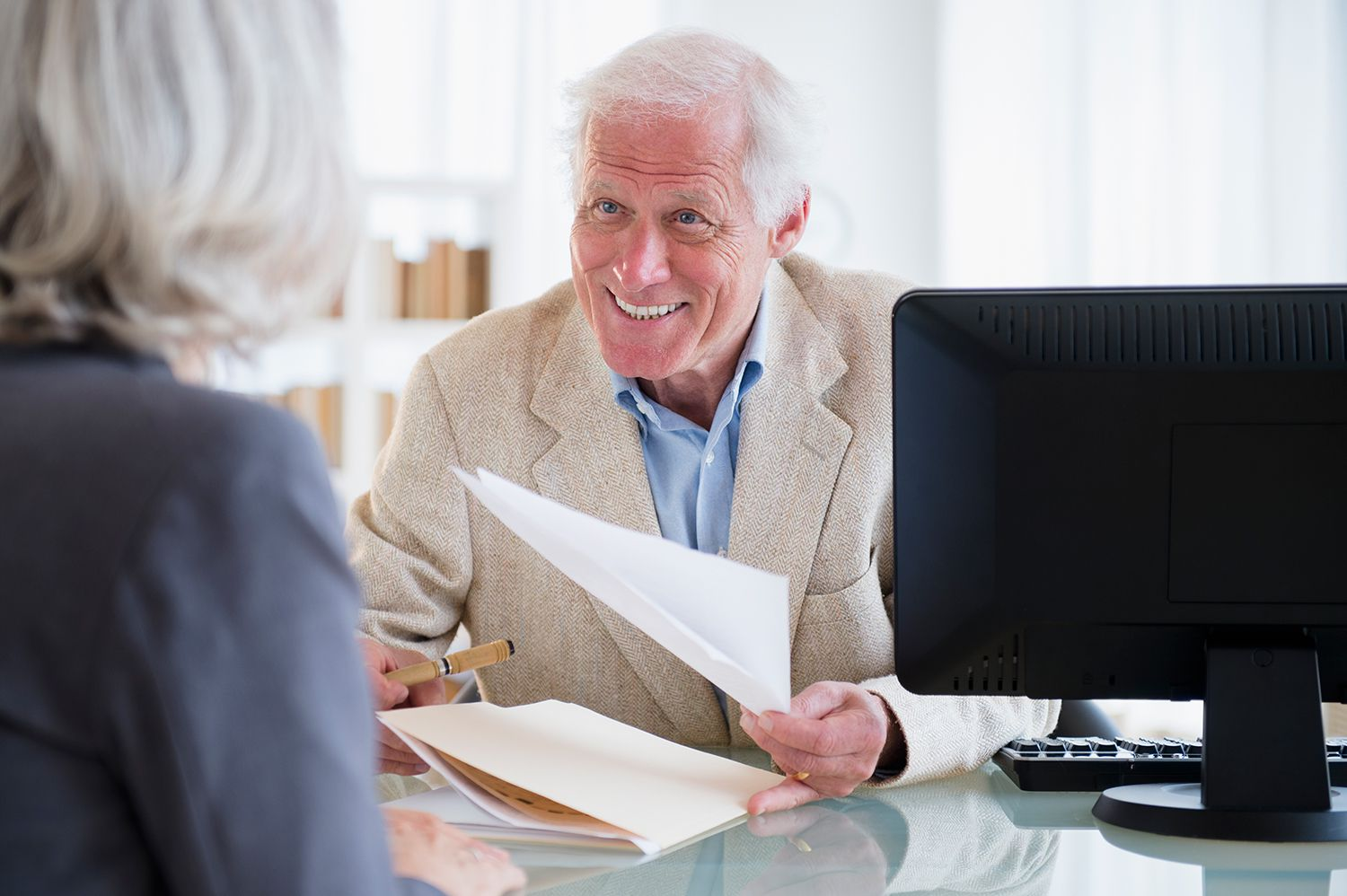 Businessman going over papers with woman