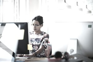 A businesswomen working in a modern office