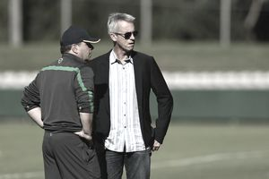 Sports manager and coach on football field